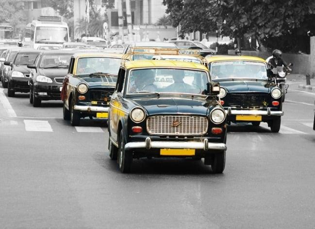 Foto  behang Mumbai Taxi CL73A