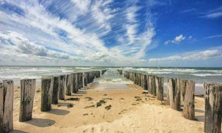 Foto behang Strandpalen Zeeland Holland 7504